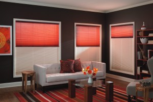 orange window shades and a window shutter installed in the living room