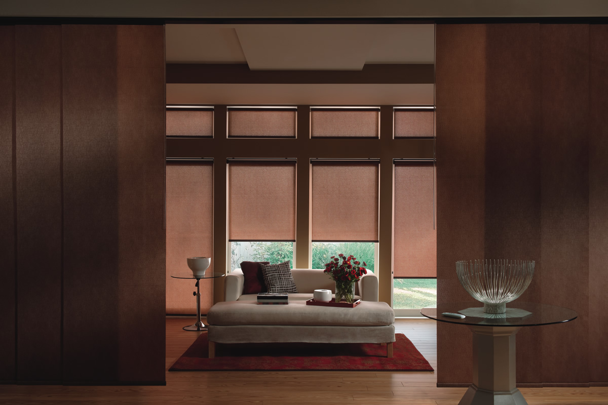 brown roller shades in a brown painted bedroom