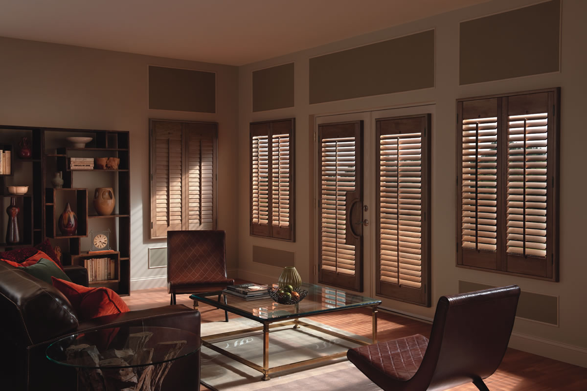 brown wooden shutter installed in living room doors and windows