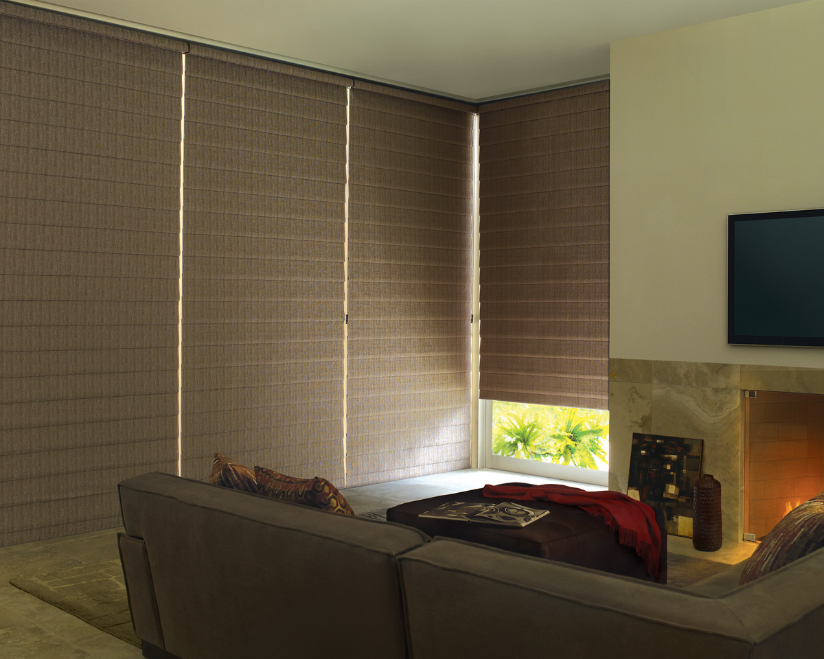 brown cellular shades installed in a glass window