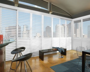 an office surrounded by white window shutters