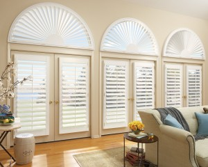 white window shutters installed in the doors of a living room