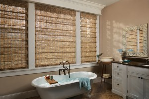 brown roman shades in a brown painted bathroom