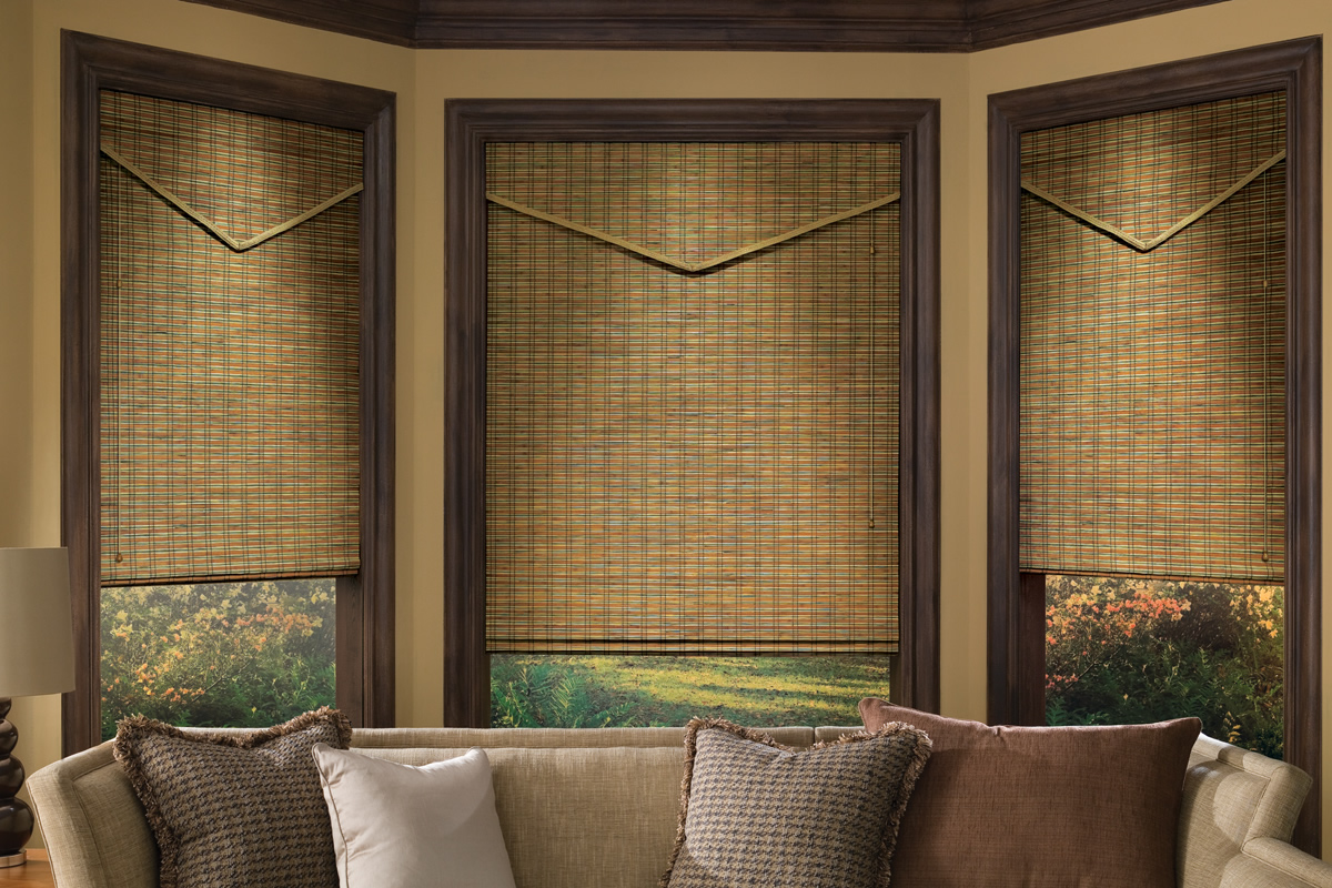 brown roman shades in a living room