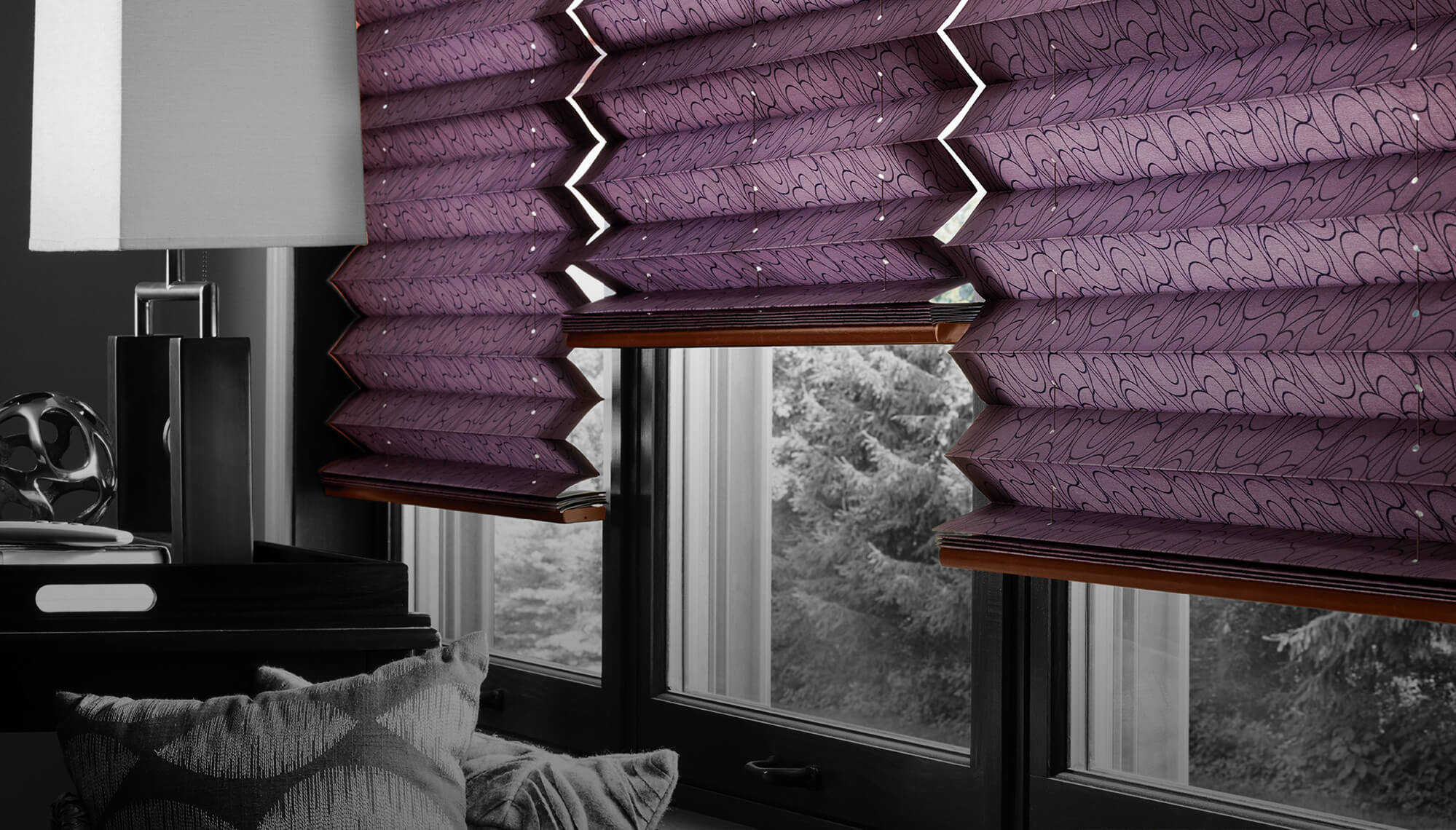 a gloomy scene of a purple pleated shades in a glass type window