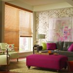 A brown window blinds installed on a window glass inside the living room.