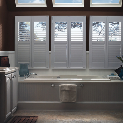 white window shutter installed in the bathroom with bathtub