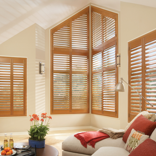 wooden window shutter in a white painted living room